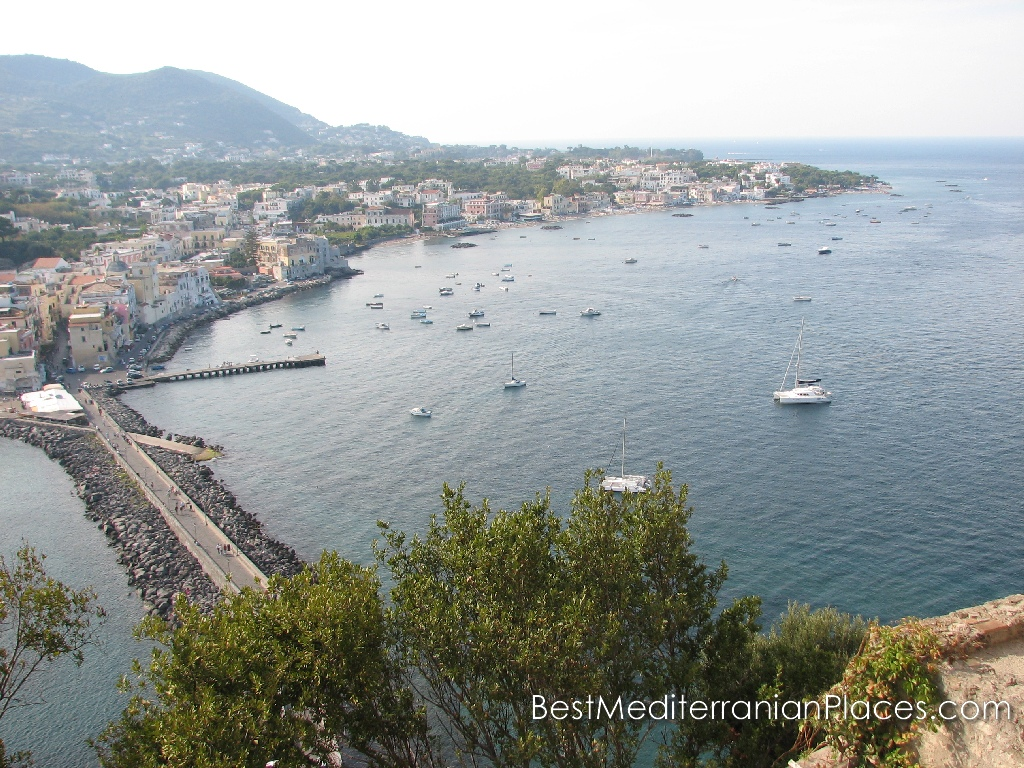 Last look at Ischia Ponte, the fishing village and the sea at sunset