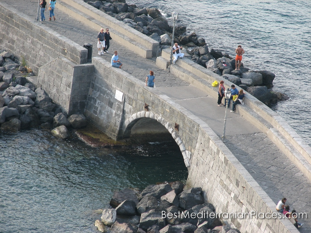The view from the heights of the castle walls to fishermen and tourists strolling across the bridge