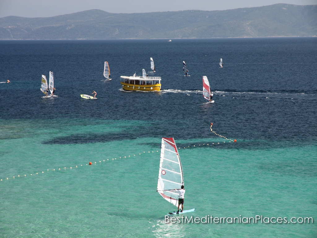 Windsurfing - favorite entertainment while relaxing on the island of Brac in Croatia