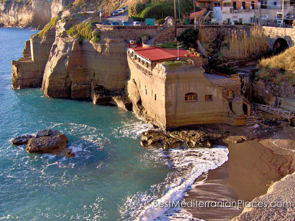 House on the bank near the Sant - Angelo carved right into the coastal cliff