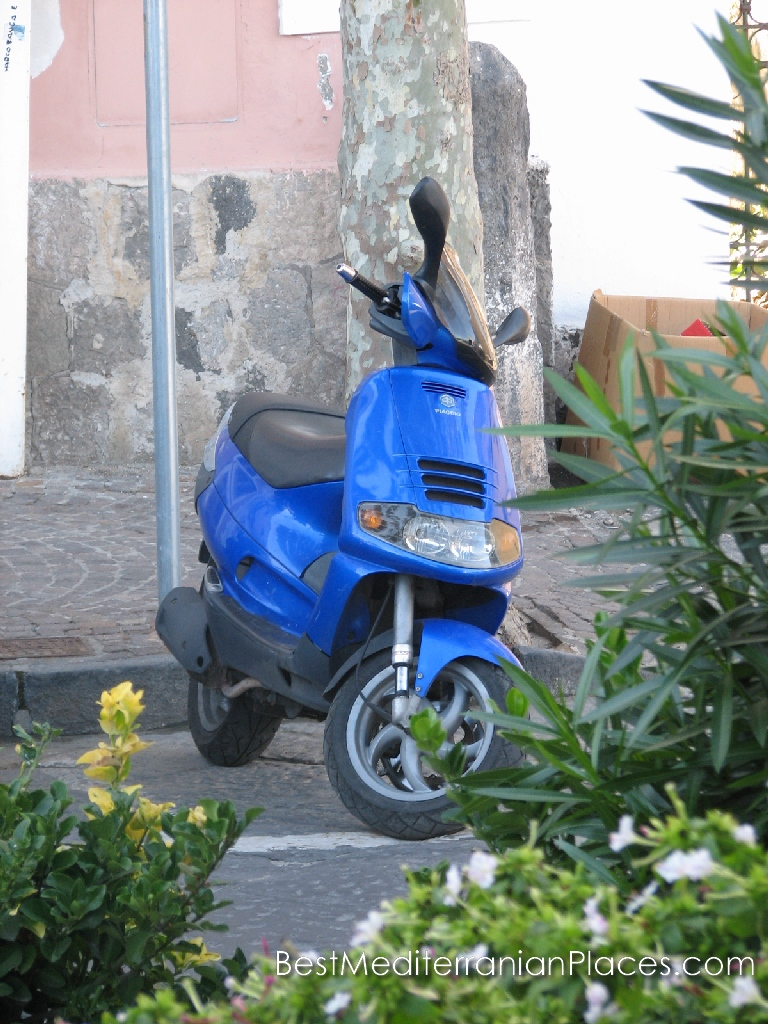 A trip on a scooter is the most convenient way to travel through the narrow and steep streets of the city
