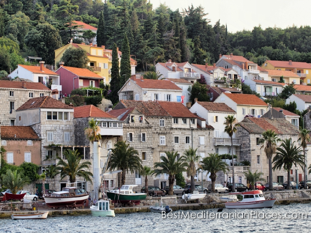 Quay of the island of Korcula and the house is surrounded by Mediterranean vegetation,