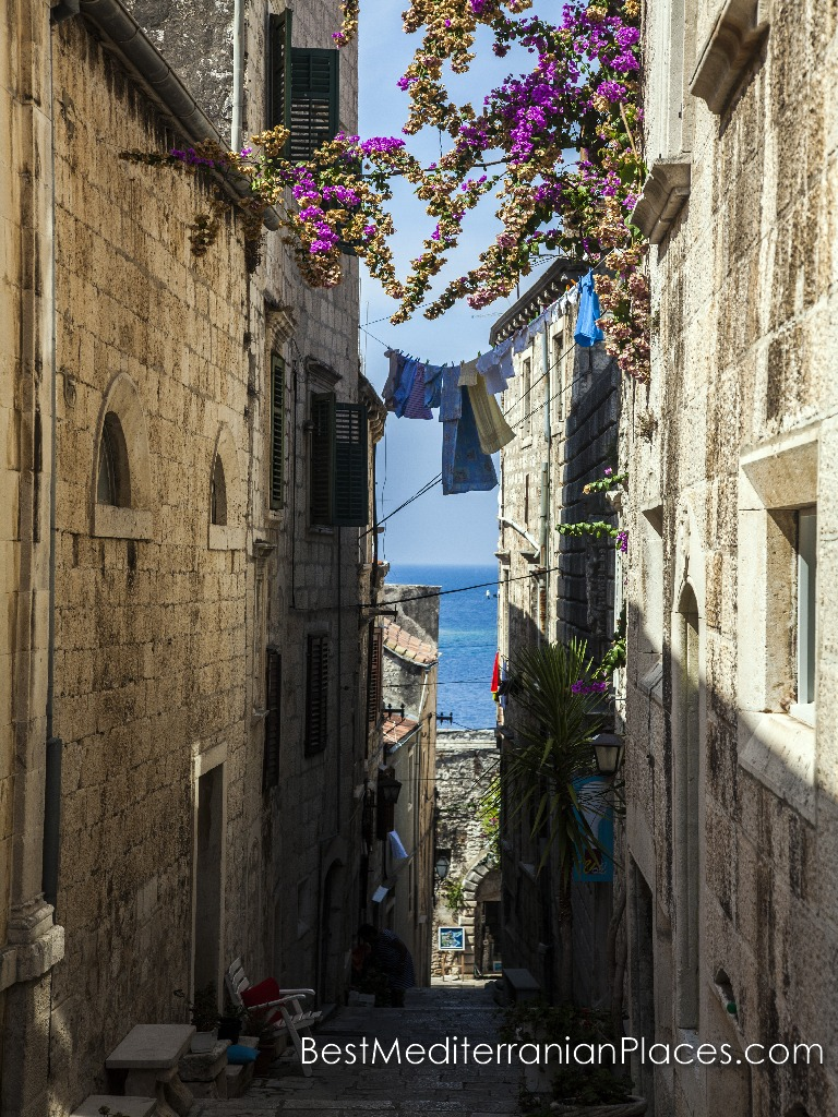 The narrow streets of the old town of Korcula Island out to sea