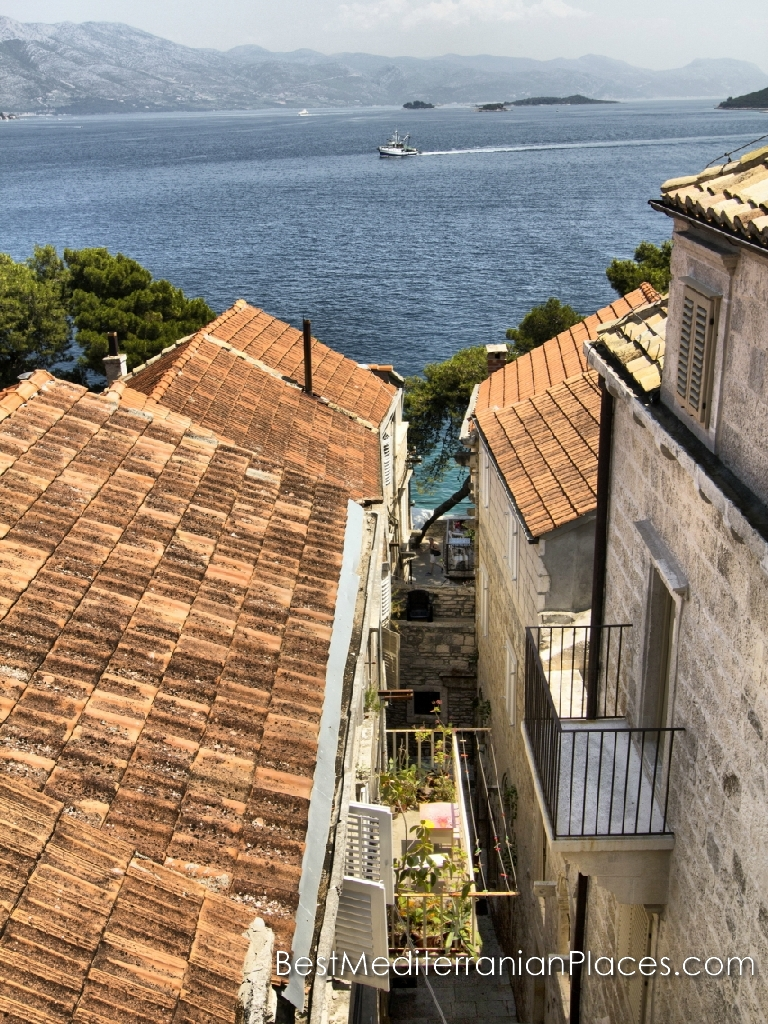 The upper floors of the houses offer a view of the Adriatic