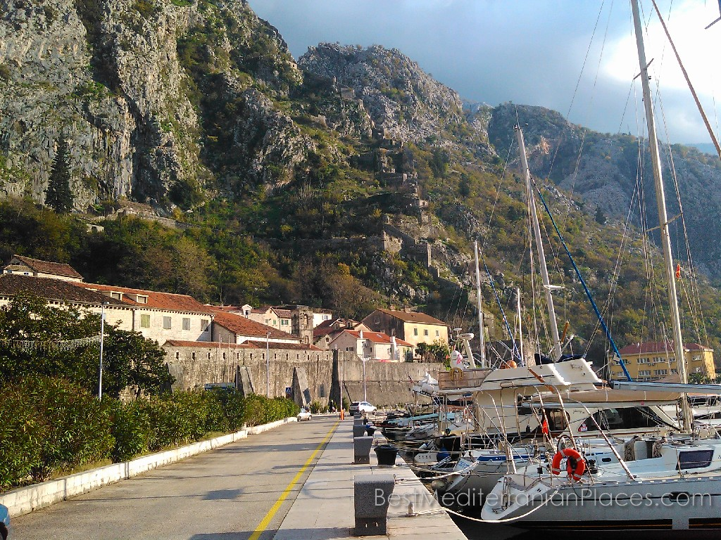 Old Kotor. Marina and views of the part of the fortress wall on the hillside