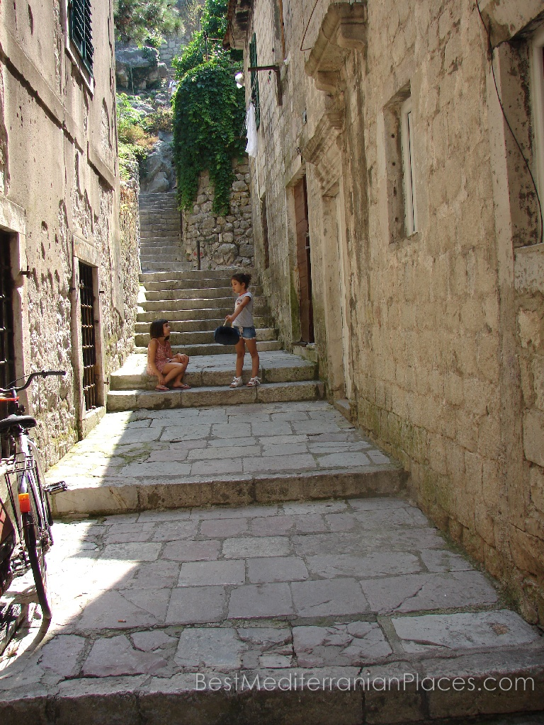 Young children playing on the streets of the old Kotor