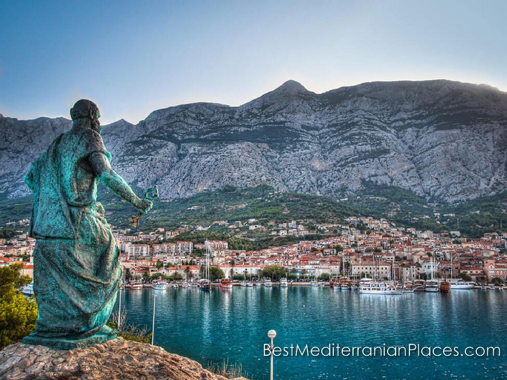 Panorama of Makarska with a monument of St. Peter