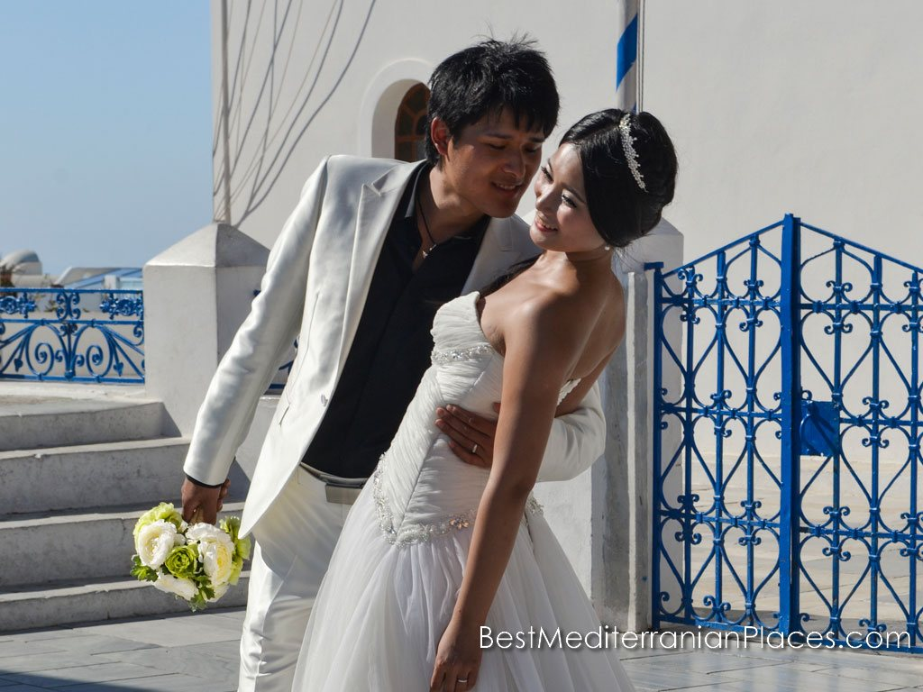 A romantic wedding in Santorini attracts many couples