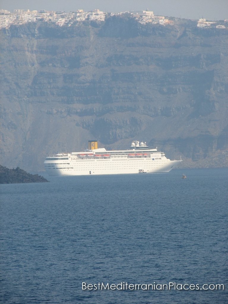 Huge cruise ship near the coast of Santorini