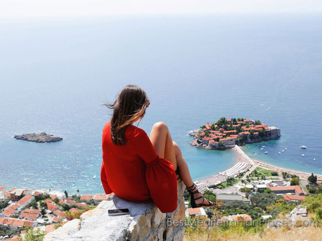 The village of Sveti Stefan stretched along the coast of the bay