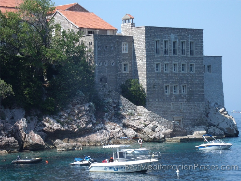 The walls of the village houses Sveti Stefan from the sea
