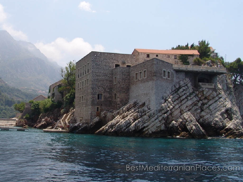 Scenic cliffs edge on which houses are built village of Sveti Stefan