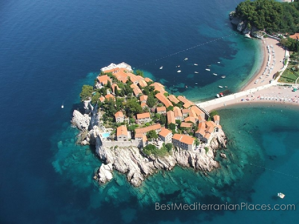 Thus appears the island of Sveti Stefan with altitude gull