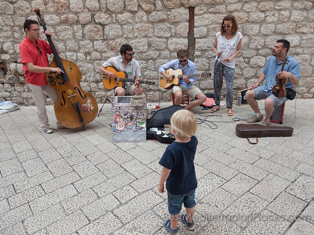 Street musicians entertain tourists in Dubrovnik Mediterranean jazz.