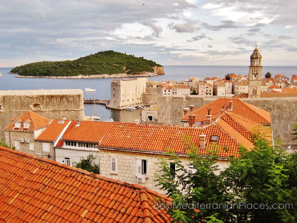 Picturesque and romantic Lokrum Island and tiled roofs of old Dubrovnik houses