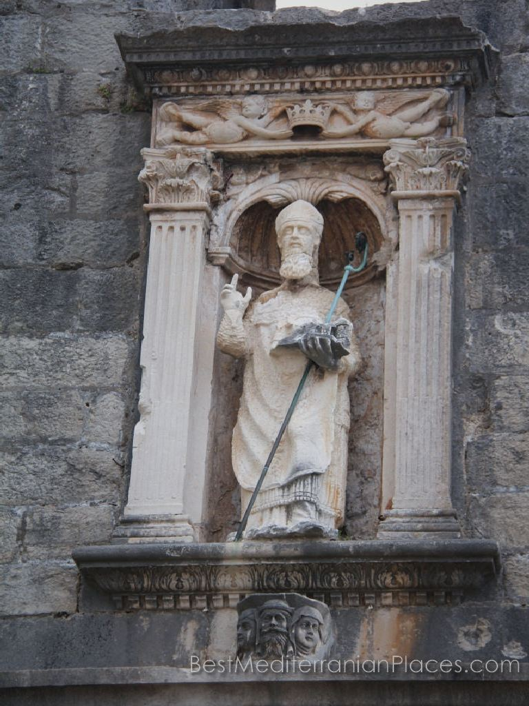 A sculpture of St. Vlaho above the entrance to the main gate to the old Dubrovnik fort