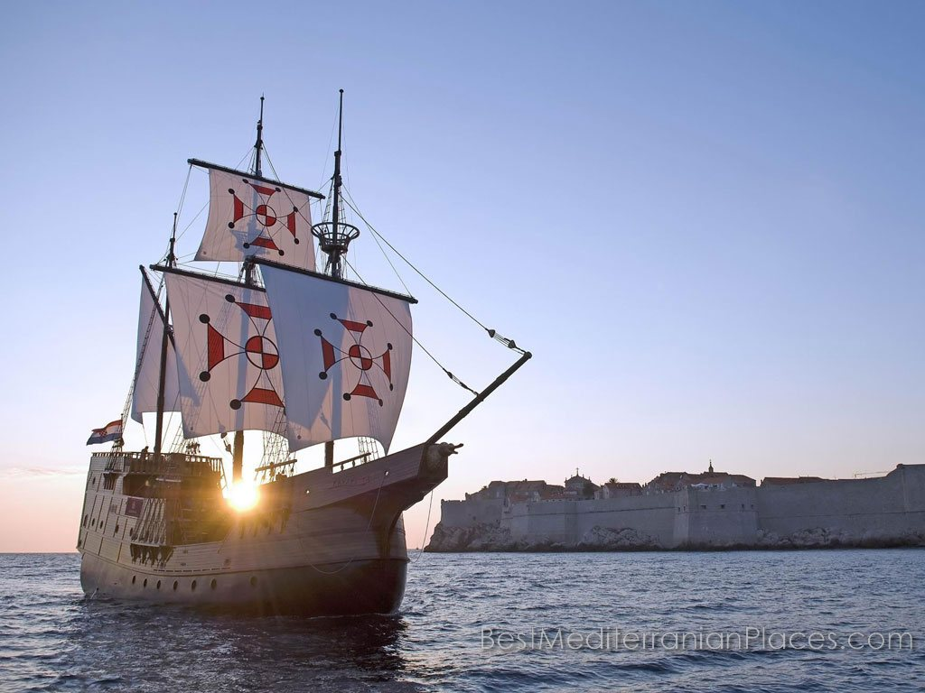 Replica of a traditional ˝Karaka˝ ship against the background of the old fortress of Dubrovnik