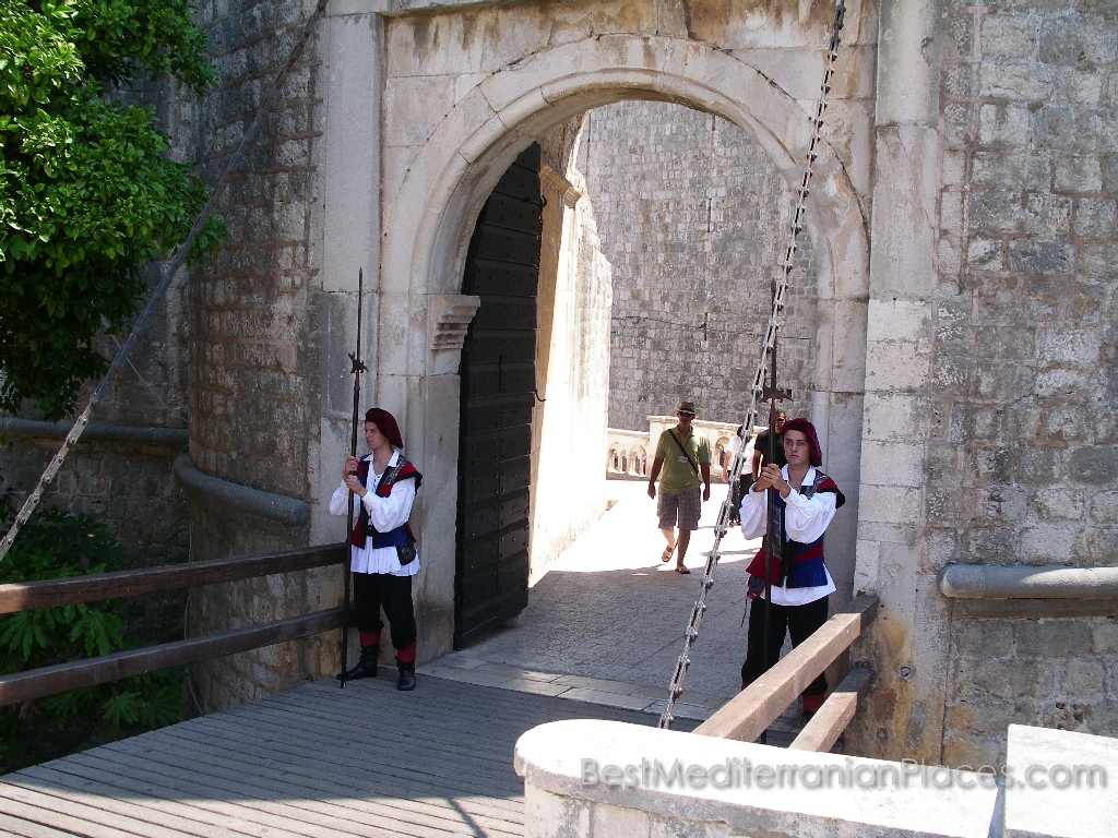 Guardians at the main gate of the fortress are dressed in clothes that were worn in the Middle Ages