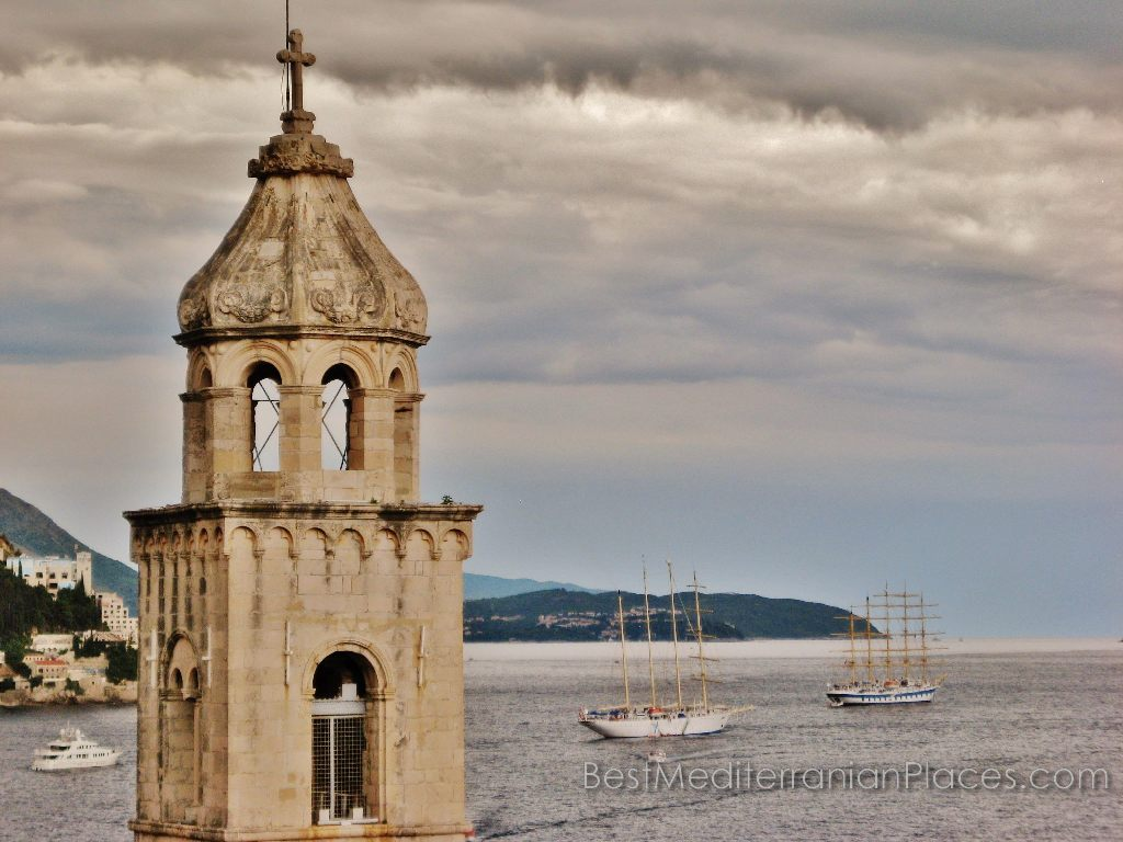 Sailboats in the bay on the background of Bell Tower (Dubrovnik, Croatia)